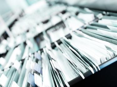 Piles of files, photo by Ioana Davies (Drutu)/AdobeStock