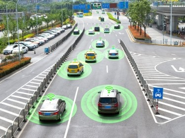 Autonomous vehicles driving on a city road with a graphic circle representing sensors. Photo by JIRAROJ PRADITCHAROENKUL / Getty Images