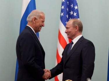 Then vice president Joseph Biden shakes hands with Russian prime minister Vladmir Putin in 2011