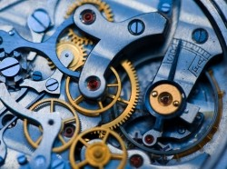 A close-up image of the inner workings of a clock. Photo by seraficus / Getty Images