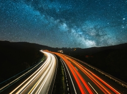 A highway at night under a starry sky