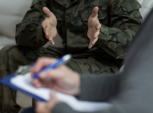 Close up of a therapist speaking with a member of the armed forces
