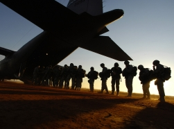 U.S. Army paratroopers board a C-130 Hercules aircraft