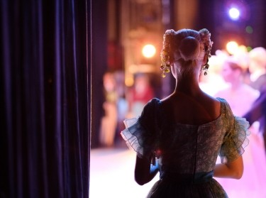 A ballerina awaiting the moment of entering the stage in the play