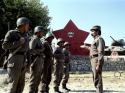 Officer giving instructions to young Afghan soldiers