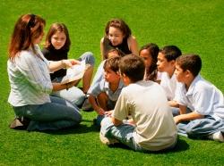 teacher and children outside