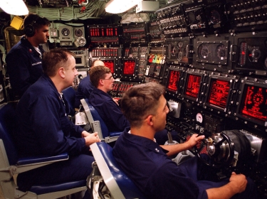 At sea aboard USS Seawolf, personnel man the underway main control watch