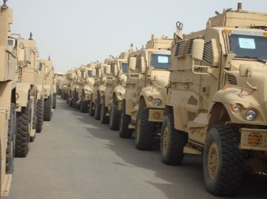 MRAPs lined up for deployment