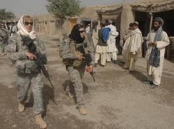Female Engagement Team members Pfc. Kelly Shutka, Pfc. Rachel Miller, and Sgt. Richelle Aus patrol a bazaar in Zabul province, Afghanistan.