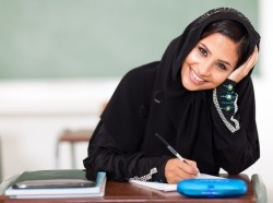 happy female middle eastern high school student