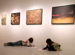 Children draw under a work by artist Ramsis Younan at the Mathaf: Arab Museum of Modern Art in Doha, Qatar, December 30, 2010