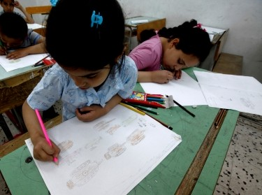 "Children draw at a workshop of an association named ""Our Children Are with Rebels"" in Misrata, Libya, June 1, 2011"