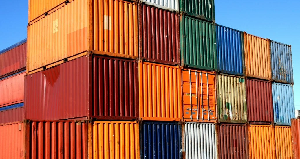 A stack of shipping containers of different colors