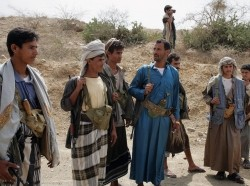 Yemeni Huthi rebels supervise the reopening of a road in Sa'da, north of San'a, on February 16, 2010, following a truce between the rebels and government forces that ended six months of fighting