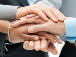 Teamwork, support, and diversity represented by many different hands