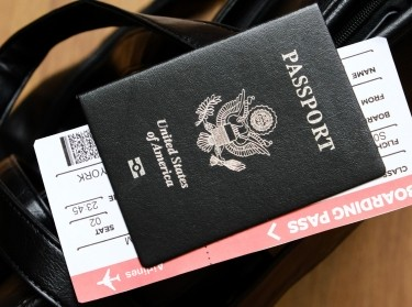 A US passport with a boarding pass inside