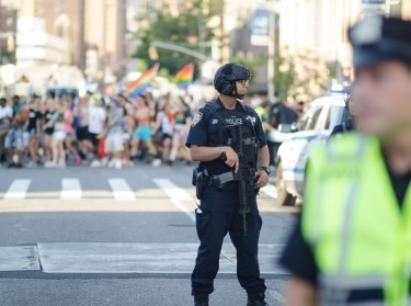 Counter-terrorism police stand guard on a cleared street at the annual Gay Pride Parade in Greenwich Village.