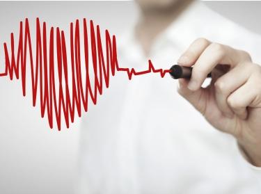 Man drawing a heartbeat-style heart