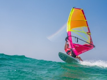 A woman windsurfing, photo by simonkr/Getty Images