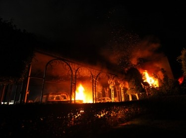 The U.S. Consulate in Benghazi is seen in flames during a protest by an armed group said to have been protesting a film being produced in the U.S. September 11, 2012