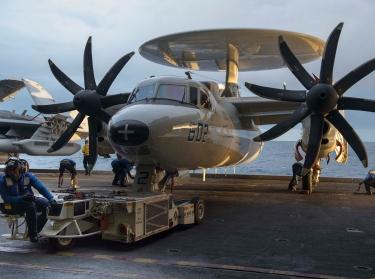 Navy Sailors move an E-2C Hawkeye