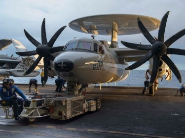Navy Sailors move an E-2C Hawkeye