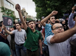 Supporters of reformist candidate Mir Hossein Mousavi, some wearing green, the color of the party, gather on the streets June 13, 2009, to protest the results of the Iranian presidential election in Tehran, Iran