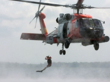 Aviation Survival Technician (AST) Jumps From a U.S. Coast Guard Helicopter