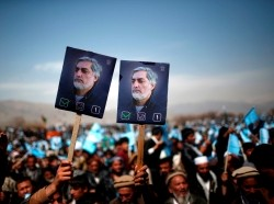 Supporters of Afghan presidential candidate Abdullah Abdullah hold posters of him during an election rally in Parwan province, northern Afghanistan, March 20, 2014