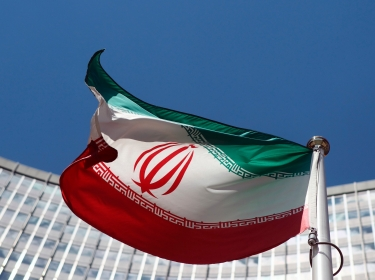 An Iranian flag flutters in front of the UN headquarters in Vienna June 17, 2014 as six world powers and Iran began their fifth round of nuclear negotiations
