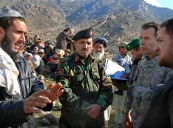 U.S. Army colonel leads an investigation team to meet with villagers in Tagab, Afghanistan, January 27, 2009