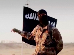 A masked man speaking in what is believed to be a North American accent in a video that Islamic State militants released in September