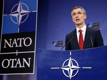 NATO Secretary General Jens Stoltenberg addresses a news conference during a NATO defense ministers