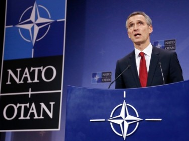 NATO Secretary General Jens Stoltenberg addresses a news conference during a NATO defense ministers meeting in Brussels, February