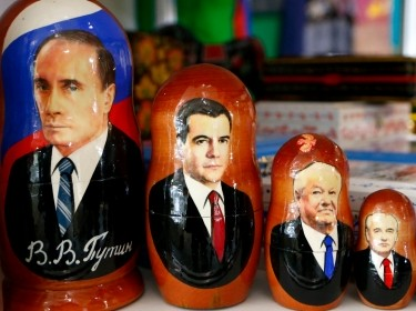 Russian nesting dolls bearing the faces of Russian leaders are displayed in a souvenir shop near Sochi, February 21, 2014