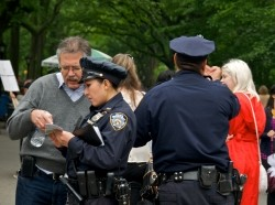 NYPD officers interact with pedestrians in Central Park, Manhattan, May 22, 2011