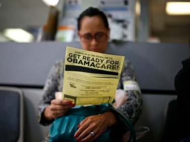 Arminda Murillo, 54, reads a leaflet at a health insura