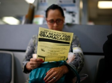 An attendee at a health insurance enrollment event in Cudahy, California reads