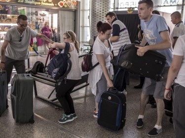 Tourists leave from the Enfidha international airport in Sousse, Tunisia, June 27, 2015, after being evacuated following a terrorist attack on the beach