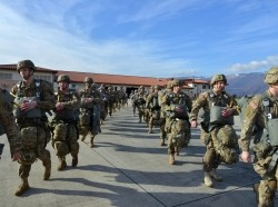 U.S. Army paratroopers prepare to board an Air Force C-130 Hercules aircraft on Aviano Air Base, Italy, January 8, 2016