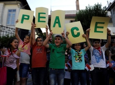 Children hold up letters spelling the word 'peace' during a day of activities and prayers at the Zaitoune historic church in old Damascus, Syria, June 1, 2016
