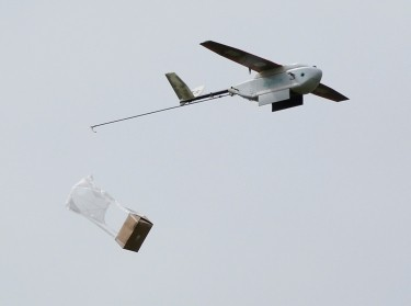 A Zipline delivery drone releases its payload during a demonstration near San Francisco, California, May 5, 2016