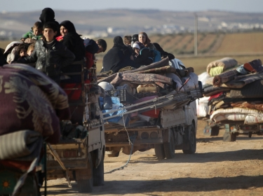 People fleeing violence in ISIS-controlled al-Bab, Syria arrive in the town's rebel-held outskirts, February 3, 2017