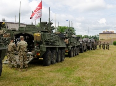 Members of Battle Group Poland stage their vehicles upon arriving at the city of Suwalki, Poland, during an exercise to enhance NATO throughout the Baltic region and Poland, June 17, 2017
