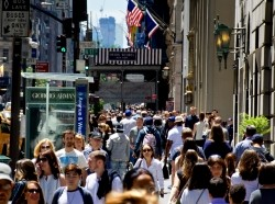 Pedestrians walk along 5th Avenue in New York City, June 14, 2016