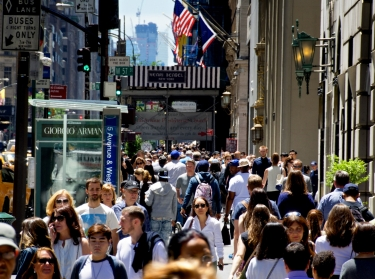 Pedestrians walk along 5th Avenue in New York City, June 14, 2016