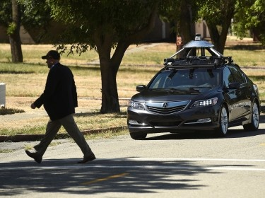 An autonomous version of Acura's RLX Sport Hybrid SH-AWD stops for a simulated pedestrian crossing at carmaker Honda's testing grounds at the GoMentum Station autonomous vehicle test facility in Concord, California, June 1, 2016