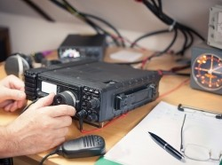 A man using a radio transceiver