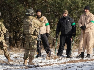 U.S. soldiers serving with deterrence forces perform a scenario-based situation exercise with Polish soldiers acting as civilians near the Bemowo Piskie Training Area, Poland, February 6, 2018