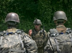 Soldiers receive a safety and mission brief before a training exercise at Joint Base McGuire-Dix-Lakehurst, N.J., June 18, 2018